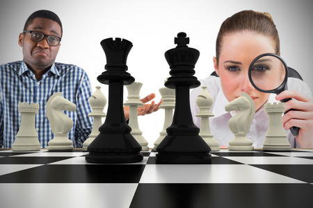 Composite image of business people with chessboard against white background with vignette Stock Photo - 29047435