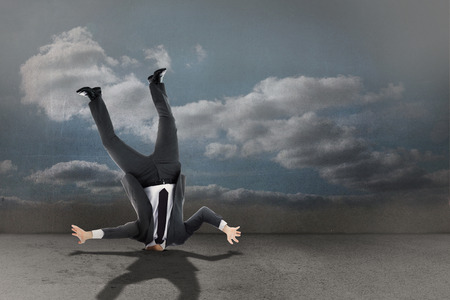 burying: Businessman burying his head against clouds in a room Stock Photo