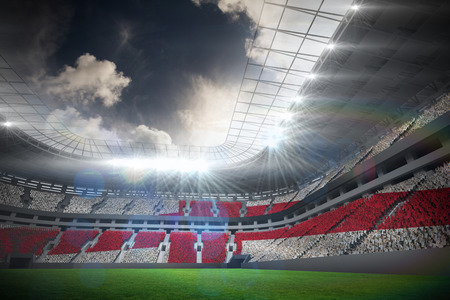 Digitally generated english national flag in football stadium with fans in white photo