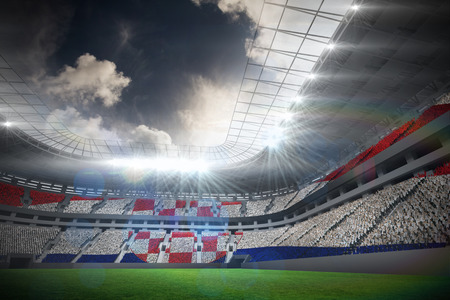 Digitally generated croatia national flag against football stadium with fans in white photo