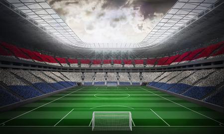 Digitally generated netherlands national flag against football stadium photo
