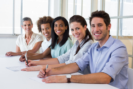 Group of workers looking at camera in the office photo