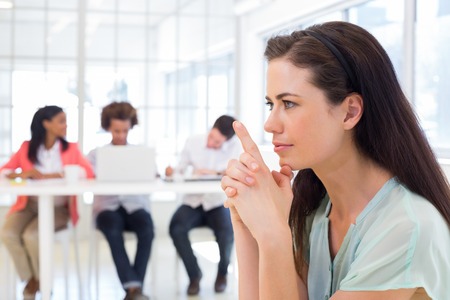 Attractive businesswoman concentrating and focusing in the office Stock Photo