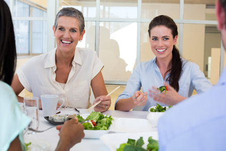 lunch hour: Business people enjoy healthy lunch in the office Stock Photo