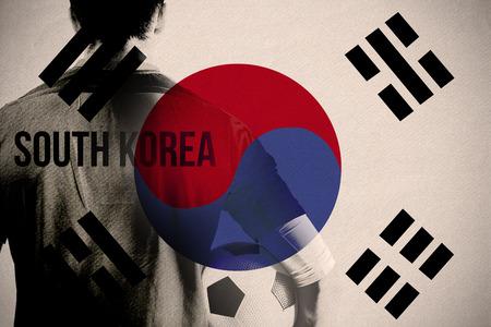 South korea football player holding ball against japan national flag photo