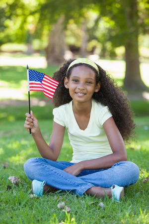 Young girl celebrating independence day in the park on a sunny day photo