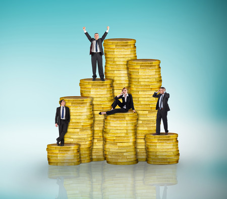 Composite image of business people on pile of coins against blue vignette photo