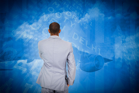 Thinking businessman against airport departures board for india photo