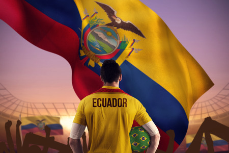 Ecuador football player holding ball against large football stadium under purple sky