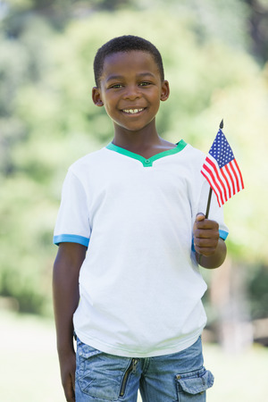 Little boy celebrating independence day in the park on a sunny day photo