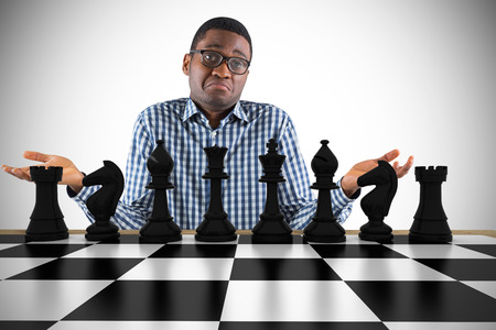 pawn adult: Composite image of young businessman shrugging shoulders with chessboard
