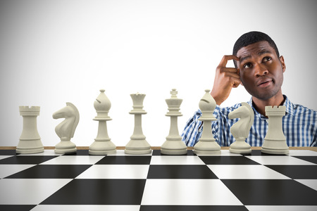 pawn adult: Composite image of thinking casual businessman with chessboard