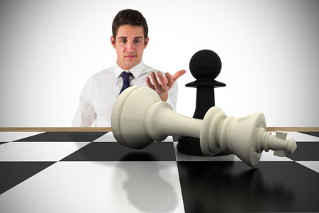 pawn adult: Businessman standing with hand out with chessboard against white background with vignette Stock Photo