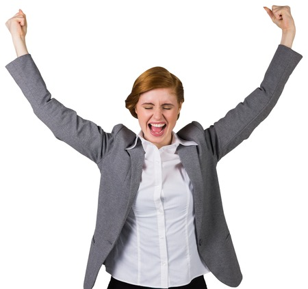 Excited redhead businesswoman cheering on white background