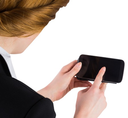 Businesswoman holding smartphone showing screen on white background photo
