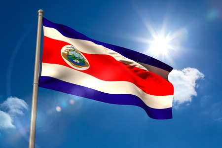 Costa rica national flag on flagpole on blue sky background photo