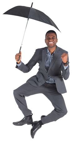 Businessman cheering and holding umbrella on white background