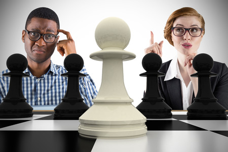 Composite image of business people playing chess against white background with vignette photo