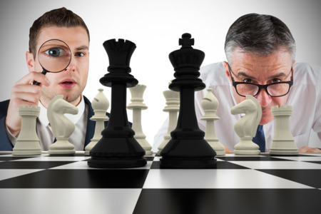 Composite image of business people with chessboard against white background with vignette Stock Photo - 29048827