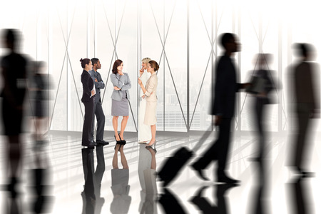 Composite image of business colleagues talking against white room with large window overlooking city photo