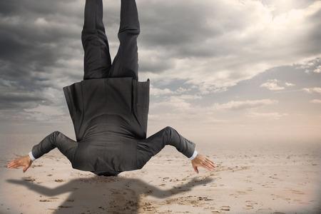 burying: Businessman burying his head against desert landscape