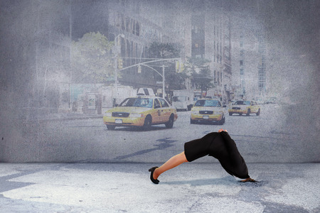 burying: Businesswoman burying her head against urban projection on wall Stock Photo