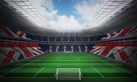 Digitally generated uk national flag against football stadium photo