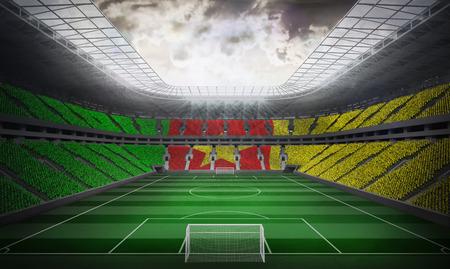 goalpost: Digitally generated cameroon national flag against football stadium Stock Photo