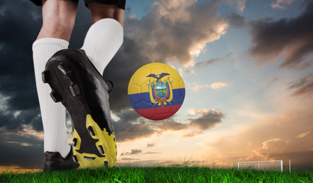 Composite image of football boot kicking ecuador ball against green grass under blue and orange sky photo