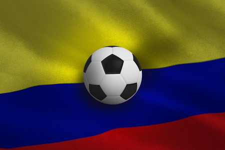 Black and white football against colombia flag background photo