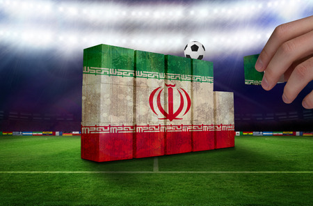 Hand building wall of  iran flag in grunge effect photo