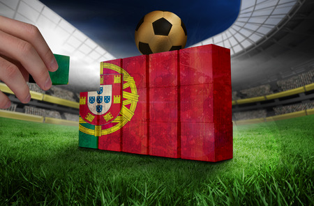 Hand building wall of portugal flag in grunge effect photo