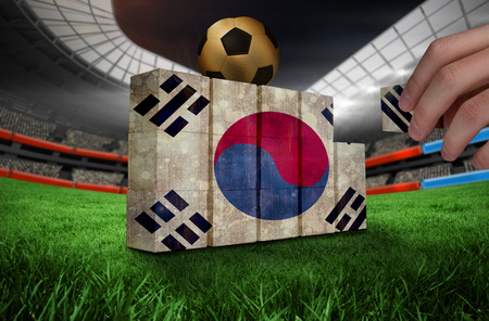 Hand building wall of korea republic flag in grunge effect photo