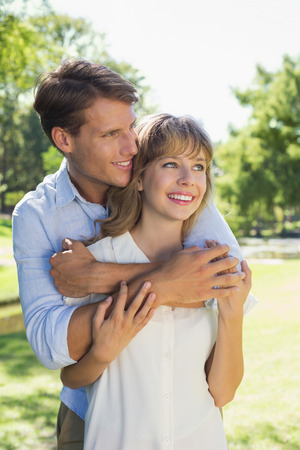 Cute couple hugging in the park and smiling on a sunny day photo