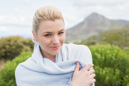 wrapped up: Pretty blonde wrapped up in blanket outside on a chilly day