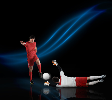 Football players tackling for the ball on black background with lights Stock Photo - 29053478