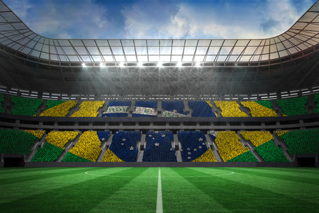 Digitally generated large farge football stadium with brasilian fans photo