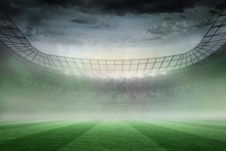 Digitally generated misty football stadium under spotlights