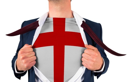 Businessman opening shirt to reveal england flag on white background photo