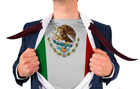 Businessman opening shirt to reveal mexico flag on white background photo