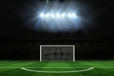 goalpost: Digitally generated football pitch under spotlights
