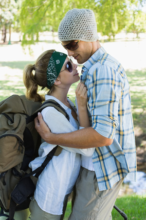 Active cute couple embracing each other on a hike on a sunny day photo