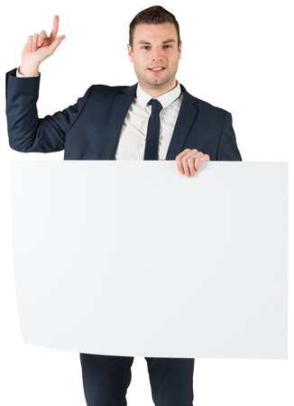 Businessman holding card and pointing on white background photo