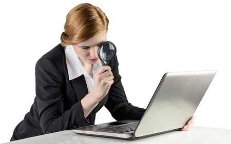 Redhead businesswoman using her laptop on white background Stock Photo - 29054597