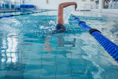 human body part: Fit swimmer doing the front stroke in the swimming pool at the leisure center