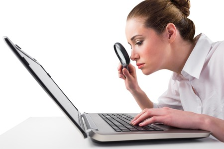 Attentive businesswoman typing on laptop on white background photo