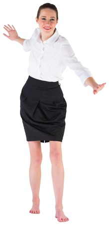 Businesswoman performing a balancing act on white background photo