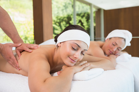 getting together: Pretty friends getting massages together in the health spa
