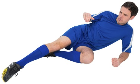 Football player in blue kicking on white background Stock Photo - 29055999
