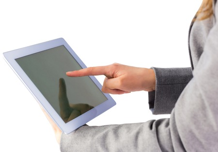 Businesswoman using a tablet pc on white background Stock Photo